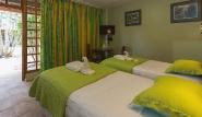 Tobago - Shepherd`s Inn, Zimmerbeispiel Gartenseite