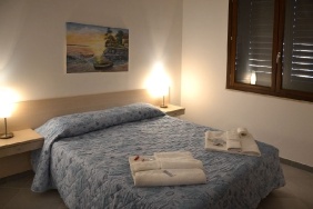 Lo Stagnone - Torre Lupa, Appartement Schlafzimmer